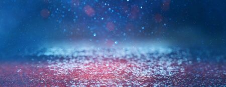 blackground of abstract glitter lights. blue, silver and black. de focused. banner Stock Photo - 128866017