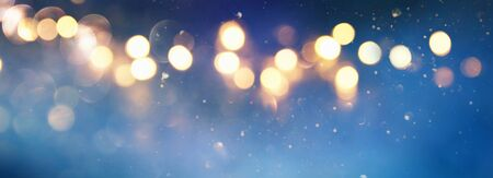 blackground of abstract glitter lights. blue, gold and black. de focused Stock Photo - 128866032