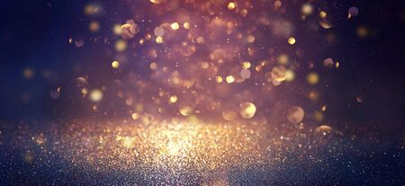 blackground of abstract glitter lights. blue, gold and black. de focused. banner Stock Photo - 128866039