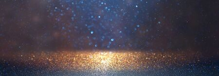 blackground of abstract glitter lights. blue, gold and black. de focused. banner Stock Photo - 128866043