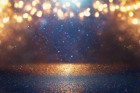 blackground of abstract glitter lights. blue, gold and black. de focused Stock Photo - 128866045