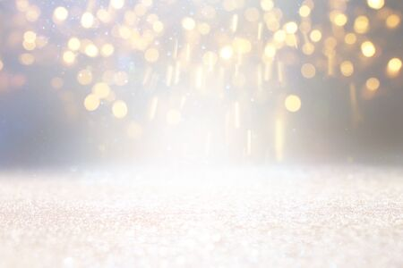 blackground of abstract glitter lights. silver and gold. de-focused
