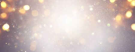 blackground of abstract glitter lights. silver and gold. de-focused. banner Stock Photo - 128866127