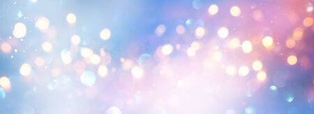 blackground of abstract glitter lights. blue, pink, gold and silver. de focused
