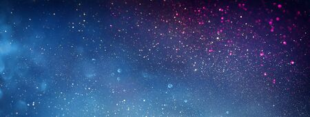 blackground of abstract glitter lights. blue, silver and black. de focused. banner Stock Photo