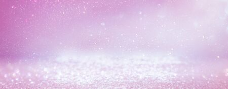 background of abstract glitter lights. purple, pink, gold and silver. de focused. banner Stock Photo