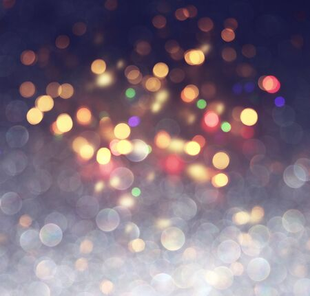 blackground of abstract glitter lights. blue, gold and black. de focused Stock Photo - 128866241