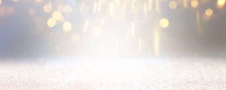blackground of abstract glitter lights. silver and gold. de-focused. banner Stock Photo