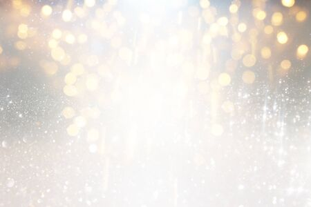 blackground of abstract glitter lights. silver and gold. de-focused Stock Photo - 128866367