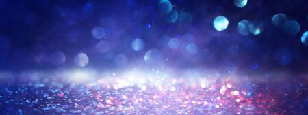 blackground of abstract glitter lights. blue, gold and black. de focused Stock Photo - 128866391
