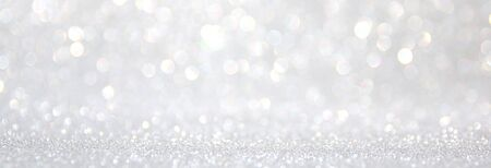 background of abstract glitter lights. silver and white. de-focused Stock Photo - 128866406