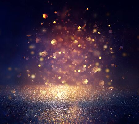 blackground of abstract glitter lights. blue, gold and black. de focused Stock Photo - 128866546