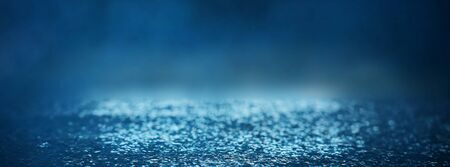 blackground of abstract glitter lights. blue, silver and black. de focused