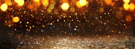 background of abstract glitter lights. gold and black. de-focused. banner Reklamní fotografie