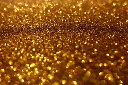 background of abstract glitter lights. gold and black. de-focused 写真素材