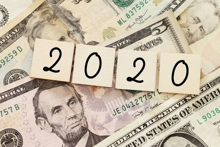 Business concept of 2020 top view with money bills. New year management, and financial plan