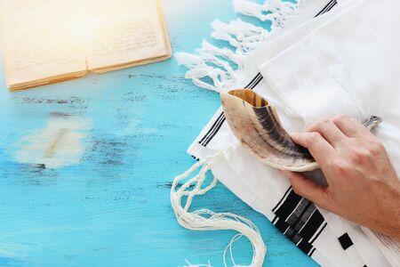 religion image of Prayer Shawl - Tallit, Prayer book and Shofar (horn) jewish religious symbols. Rosh hashanah (jewish New Year holiday), Shabbat and Yom kippur concept.