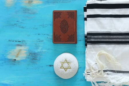 religion image of Prayer Shawl - Tallit and Prayer book jewish religious symbols. Rosh hashanah (jewish New Year holiday), Shabbat and Yom kippur concept. Stock Photo