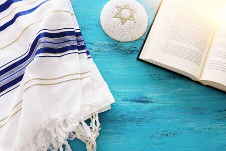 religion image of Prayer Shawl - Tallit and Prayer book jewish religious symbols. Rosh hashanah (jewish New Year holiday), Shabbat and Yom kippur concept.