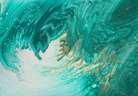 art photography of abstract marbleized effect background. turquoise, emerald green, blue and gold creative colors. Beautiful paint. Zdjęcie Seryjne