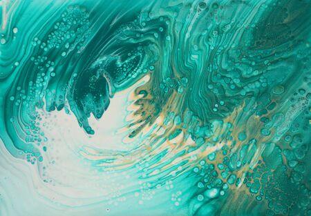Kunstfotografie des abstrakten marmorierten Effekthintergrundes. Türkis, Smaragdgrün, Blau und Gold kreative Farben. Schöne Farbe. Standard-Bild