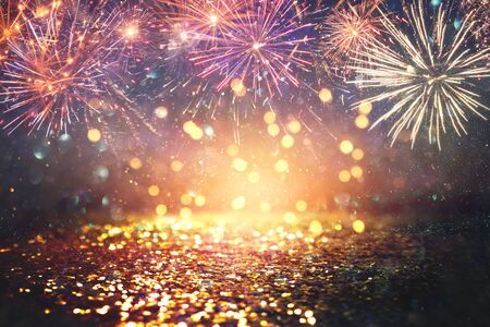 abstract gold, black and blue glitter background with fireworks. christmas eve, 4th of july holiday concept 版權商用圖片