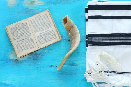 religion image of Prayer Shawl - Tallit, Prayer book and Shofar (horn) jewish religious symbols. Rosh hashanah (jewish New Year holiday), Shabbat and Yom kippur concept. banner Stock Photo
