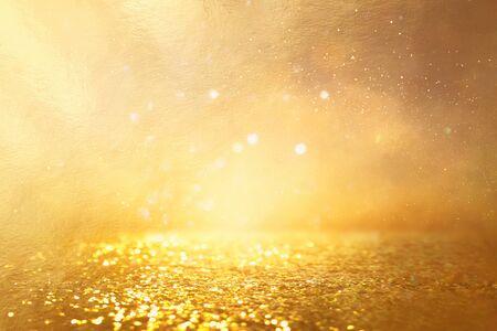 background of gold glitter lights. de focused