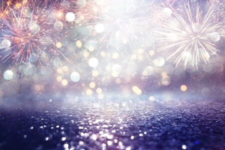 abstract gold, purple and blue glitter background with fireworks. christmas eve, 4th of july holiday concept