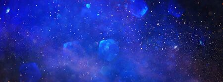 background of abstract glitter lights. blue and black. de focused. banner