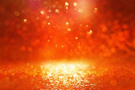 background of gold and orange glitter lights. de focused