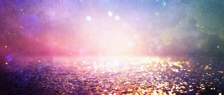 abstract glitter silver, purple, blue and gold lights background. de-focused. banner
