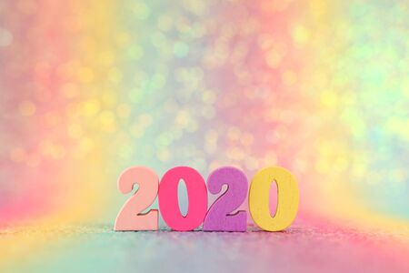 Holiday image of New Year 2020 concept. Wooden number and sparkling background Stok Fotoğraf