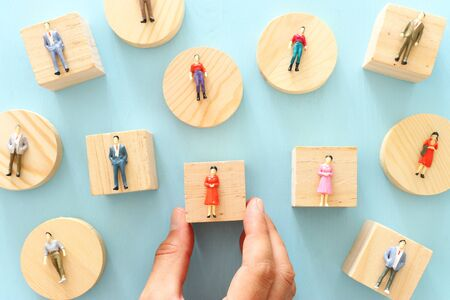 business concept image of people figures over wooden table, human resources and management concept