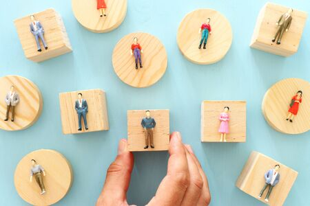 business concept image of people figures over wooden table, human resources and management concept Stok Fotoğraf