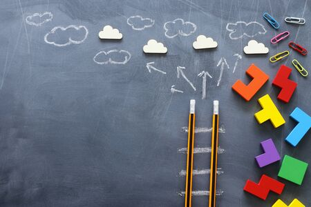 Education concept of Ladder made from pencils next to clouds over blackboard Stok Fotoğraf
