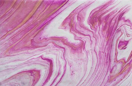 art photography of abstract marbleized effect background. pink, white, purple and gold creative colors. Beautiful paint.