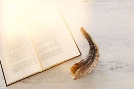 religion image of Prayer book and Shofar (horn) jewish religious symbols. Rosh hashanah (jewish New Year holiday), Shabbat and Yom kippur concept