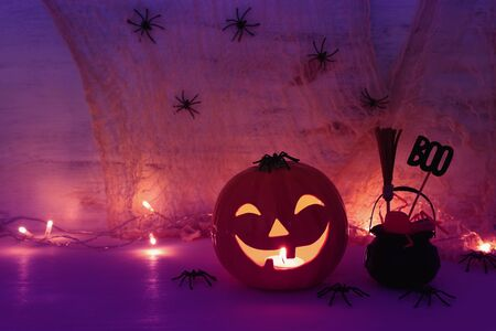 holidays halloween concept image. Pumpkin, spiders over wooden table Фото со стока