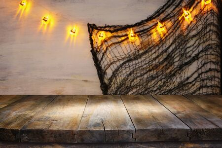 holidays concept of Halloween background with empty rustic table. Ready for product display montage. Фото со стока
