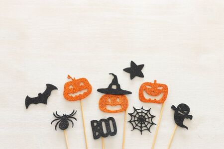 holidays image of Halloween. Pumpkins, bats over white wooden background. top view, flat lay