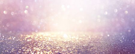abstract glitter pink, purple and gold lights background. de-focused. banner Standard-Bild