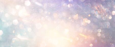 abstract glitter pink, purple and gold lights background. de-focused. banner