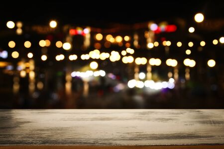 background Image of wooden table in front of abstract blurred restaurant lights Zdjęcie Seryjne