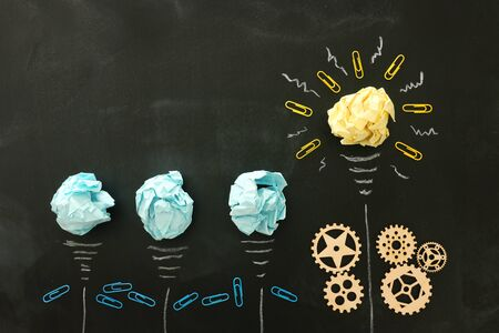 Education concept image. Creative idea and innovation. Crumpled paper as light bulb metaphor over blackboard Stockfoto