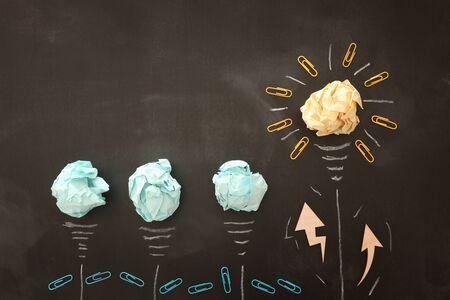 Education concept image. Creative idea and innovation. Crumpled paper as light bulb metaphor over blackboard Stockfoto
