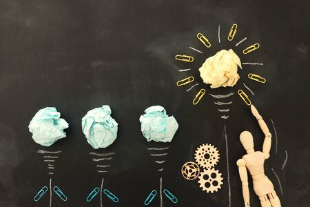 Education concept image. Creative idea and innovation. Crumpled paper as light bulb metaphor over blackboard Stockfoto - 131835212