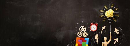 Education concept image. Creative idea and innovation. Crumpled paper as light bulb metaphor over blackboard Stok Fotoğraf