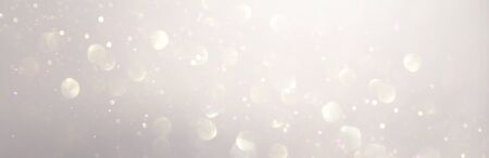 abstract backgrounf of glitter vintage lights . silver and white. de-focused. banner