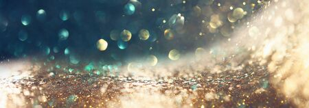 background of abstract glitter lights. gold and black. de focused. banner